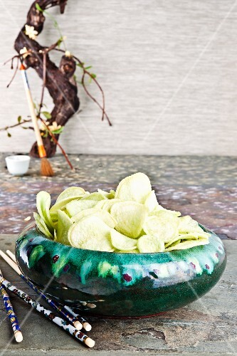 Wasabi flavoured crisps in a ceramic bowl