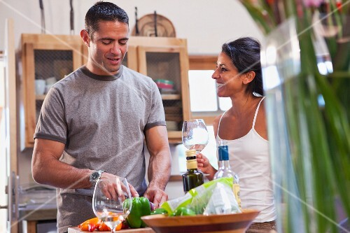 Hispanic couple preparing dinner