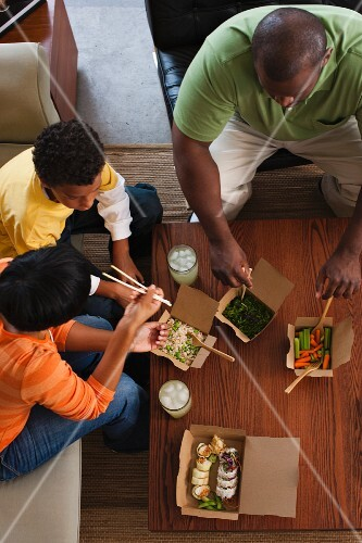 Family eating take-out Asian food