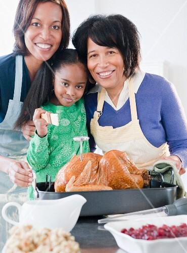Black family preparing Thanksgiving dinner