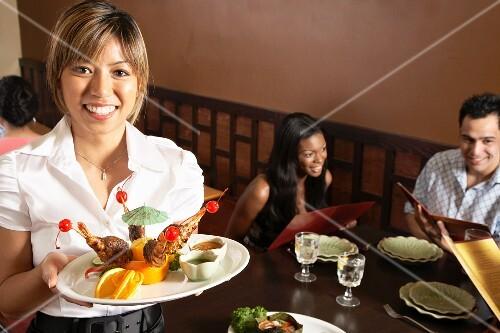 A waitress serving in a restaurant