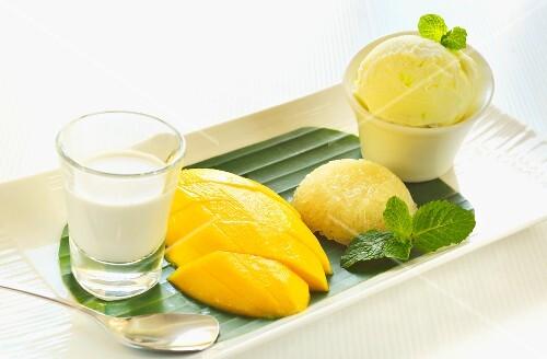Mango, sticky rice, lemon ice cream and coconut milk (Thailand)