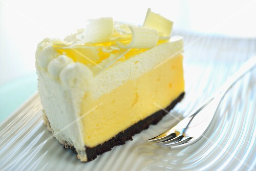 A slice of cream cake with white chocolate