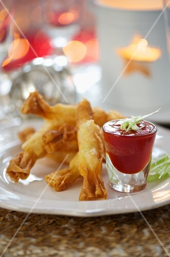 Deep-fried prawn rolls with a spicy dip