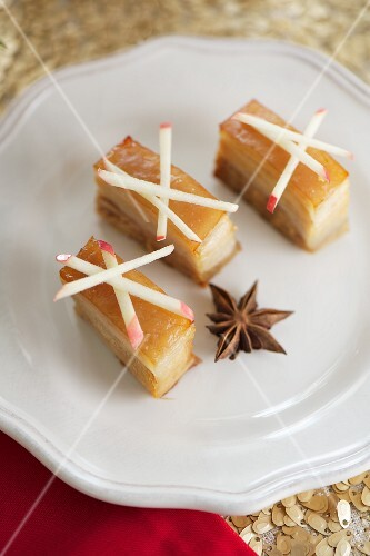 Pork belly slices with star anise and apple sticks