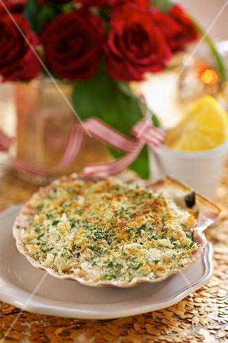 Crab gratin served in a shell with a herb crust
