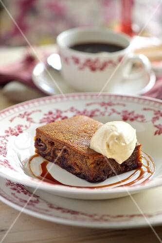 Fruitcake with vanilla ice cream and caramel sauce