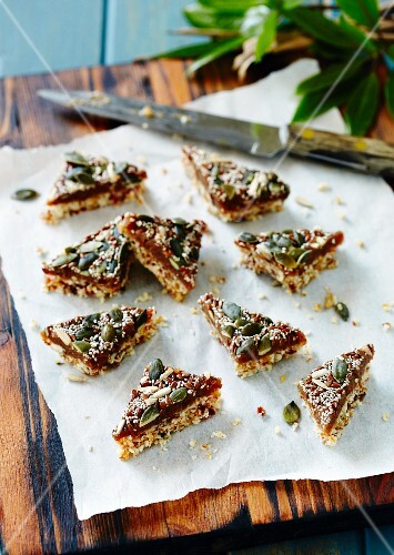 Seed and grain triangles with dates and pumpkin seeds