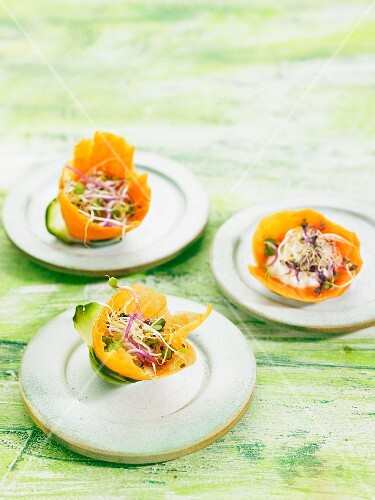 A salad of edible shoots in carrot bowls