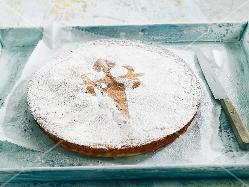 Tarta de Santiago (almond tart, Spain) with the cross of St. James