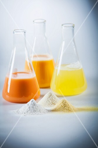 Egg yolk, egg white and mixed egg in laboratory flasks and as powder