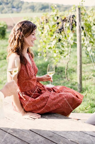 Woman in Dress Sitting on Porch Drinking Wine
