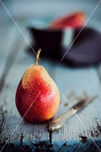 A pear on a rustic wooden table
