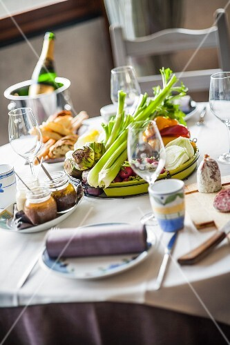 A table laid for a meal; the appetisers are served