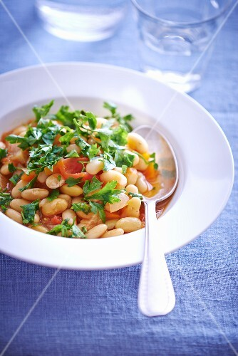 White beans with tomato sauce and herbs