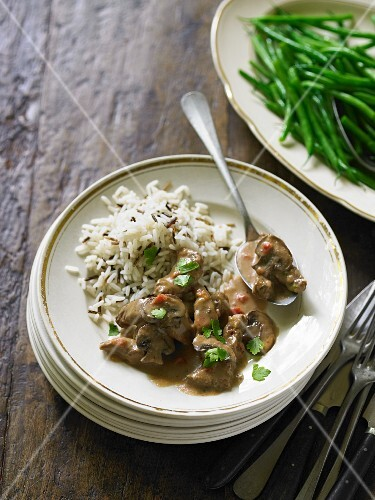 Beef stew with chestnuts in brandy sauce, served with rice and green beans