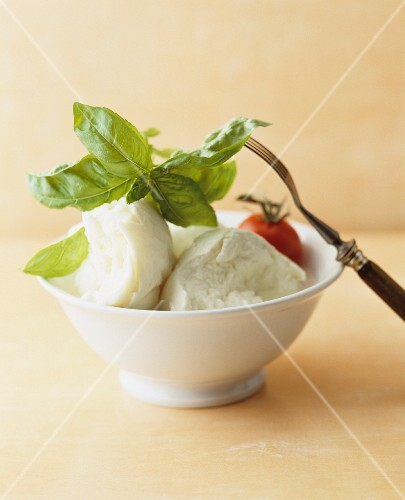 Mozarella with tomato and basil in a bowl