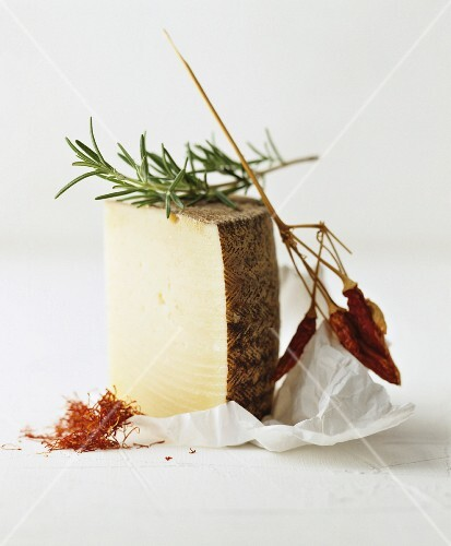 Still life featuring Manchego, saffron, rosemary and chilli