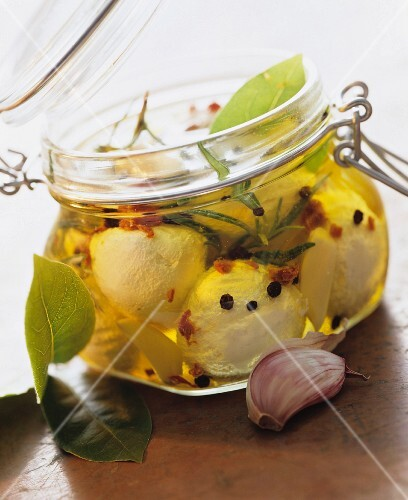 Preserved mozzarella balls in a jar