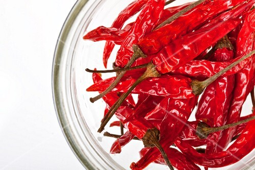Dried red chillies in a glass bowl