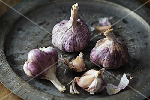 Fresh garlic on a metal tray