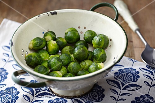 Steamed Brussels sprouts in a colander