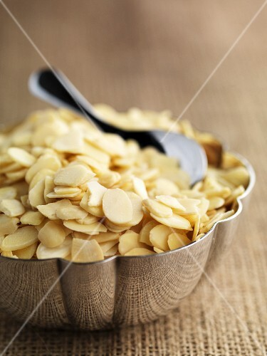 Flaked almonds in a metal bowl