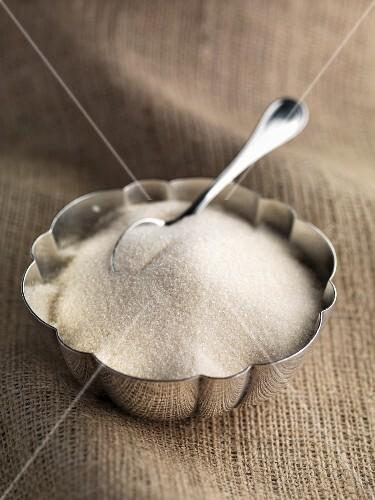 Granulated cane sugar in a sugar bowl