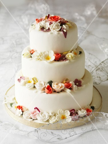 Three-tier wedding cake with fondant flowers