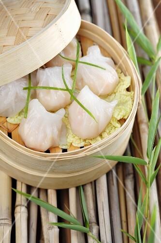 Close up of dim sum dumplings in bamboo basket