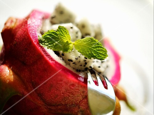 Dragon fruit salad with mint leaves (close-up)
