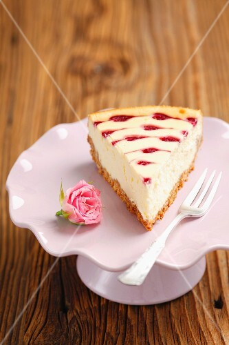 A slice of mascarpone torte with raspberry sauce