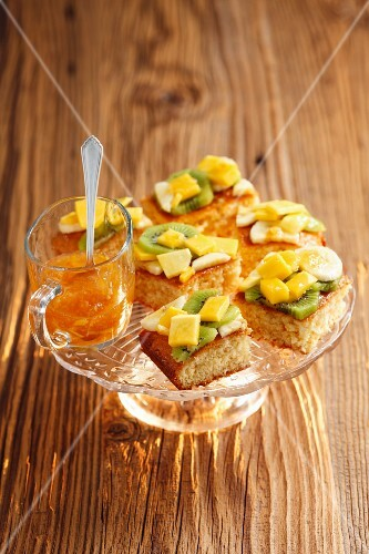 Coconut sponge slices with tropical fruit