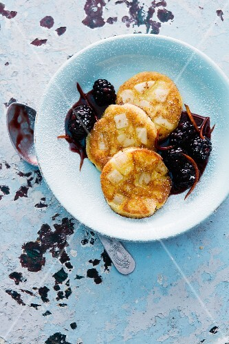 Pear and potato pancakes with blackberry sauce