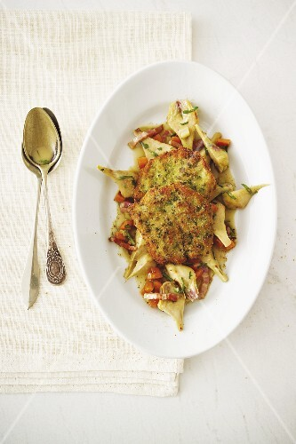 Lamb schnitzel in herb breadcrumbs with artichokes