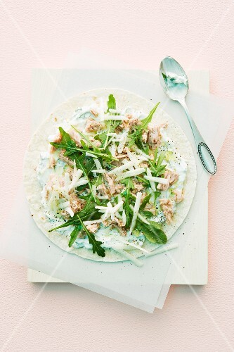 Tortilla topped with tuna and rocket