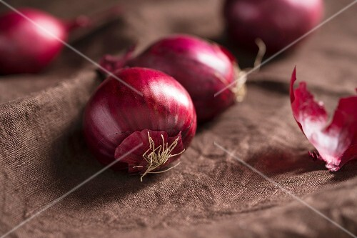 Red onions on brown material