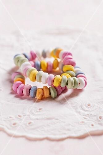 Colourful candy bracelets on a doily