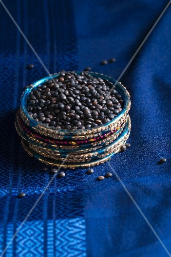Beluga lentils on a blue silk sari, in a ring made from Indian bangles