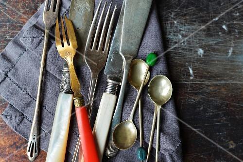 vintage knives and forks on a linen napkin