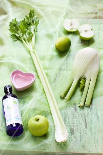 Ingredients for green vitamin juice (apple, celery, fennel, lime)
