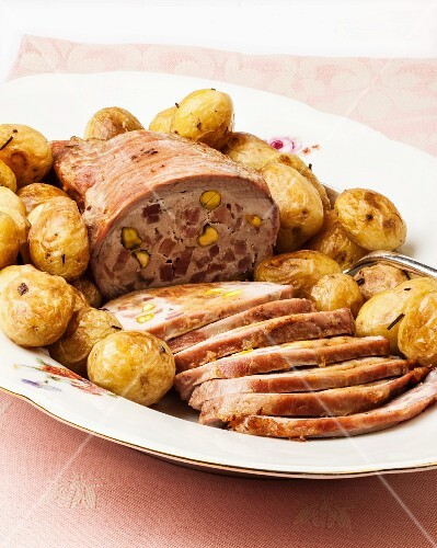 Roasted stuffed beef with potatoes