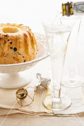 A Bundt cake and champagne glasses