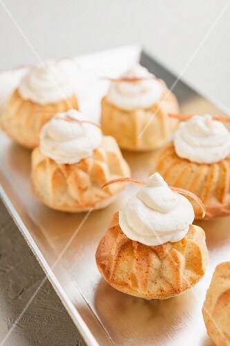 Mini Bundt cakes topped with cream