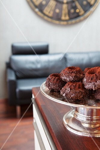 Mini chocolate Bundt cakes on a cake stand for Christmas
