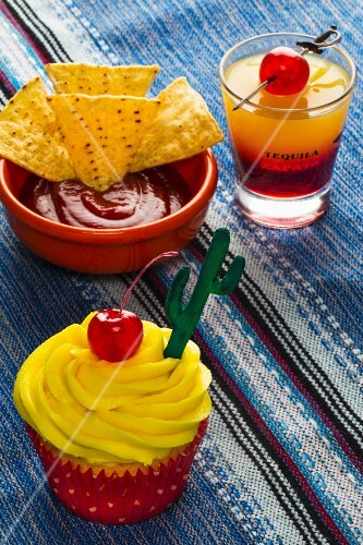 A Tequila Sunrise cupcake and cocktail