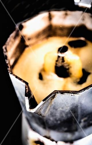 Coffee bubbling in an espresso maker