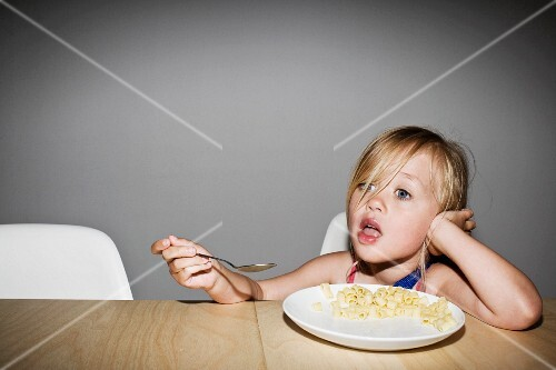 Young Blonde Girl Eating Pasta