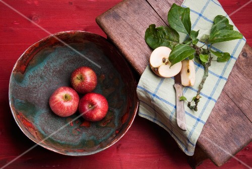 Red apples in a ceramic bowl