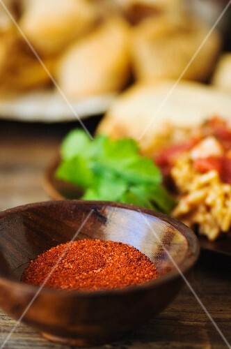 A Mexican spice mixture in a wooden bowl